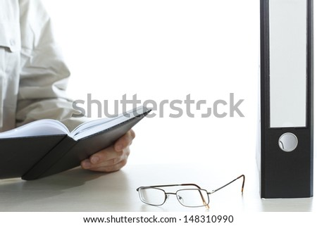 man with shcedule is working on desk - stock photo