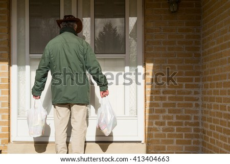 Man with shopping bags at the door