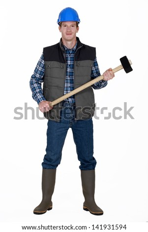 Man with sledge hammer ready to work - stock photo