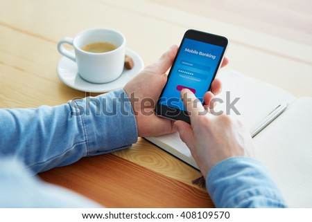 Man with smartphone is trying to log into mobile banking - stock photo