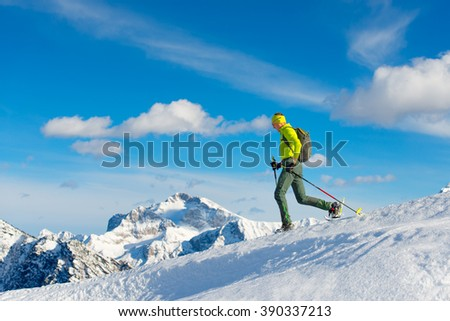 Man with snowshoes in a snowy mountain