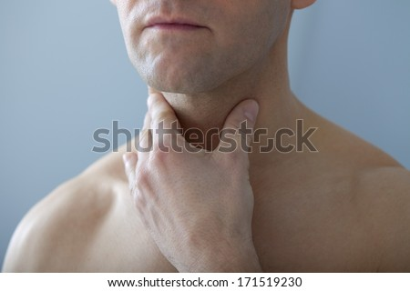 Man With Sore Throat - stock photo