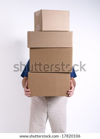 Man with 4 stacked Boxes - stock photo