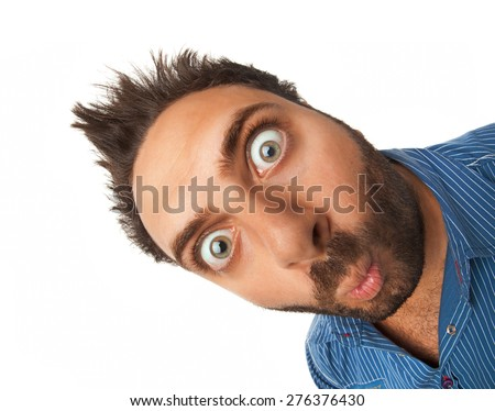 Man with surprised expression on white background - stock photo