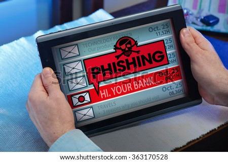 man with tablet which see an alert message with the word phishing / hands of a man looking emails in tablet with a virus message  - stock photo