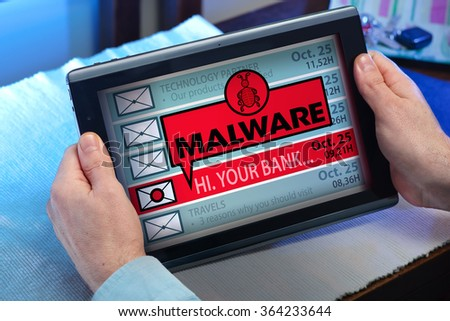 man with tablet which see emails and alert message with the word malware / hands of a man looking inbox in tablet with a malware message - stock photo