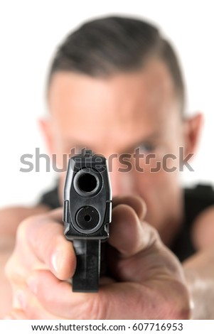 Man with tactical vest and gun isolated in white