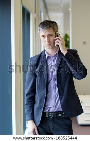 man with the phone in the office - stock photo
