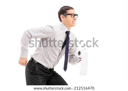 Man with toilet paper rushing to a bathroom isolated on white background