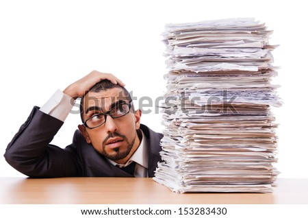 Man with too much work to do - stock photo