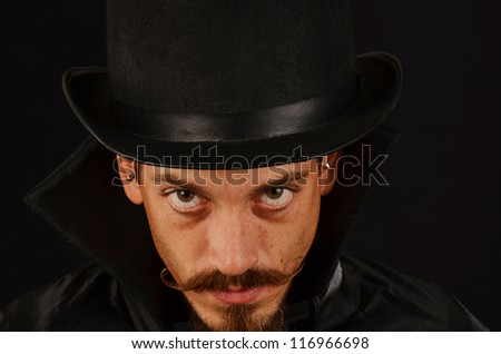 Man with top hat and cape with evil expressions/Evil Villain/Man who is dastardly - stock photo