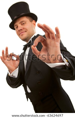 Man with top hat making 'ok' gesture - stock photo