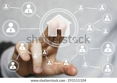 Man with touchscreen house home network web icon - stock photo