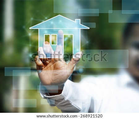 Man with touchscreen house sign network web - stock photo