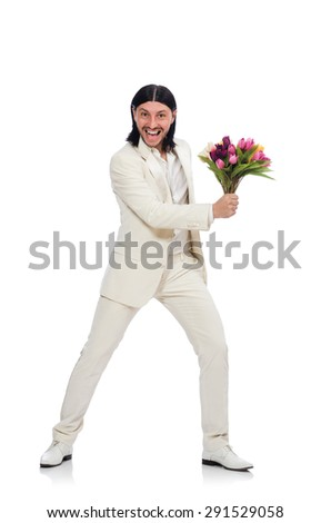 Man with tulip flowers isolated on white - stock photo