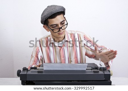 man with typewriter at work, business