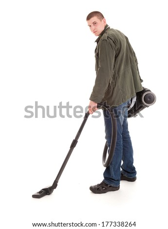 man with vacuuim cleaner, full lenght, white background - stock photo
