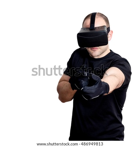Man with virtual reality headset playing video games shooting a shotgun isolated on white background. Futuristic gaming and console concept.