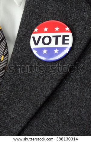 man with Vote button  pinned on his  suit