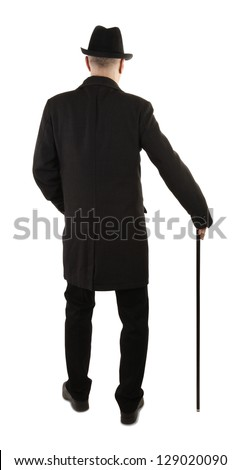 Man with walking stick rear view - stock photo