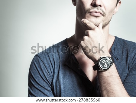 Man with watch thinking.  - stock photo