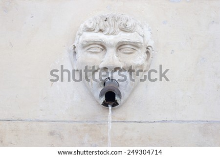 Man with water coming out of his mouth fountain