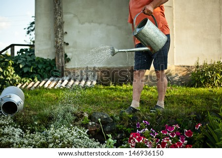 Man with watering-cans