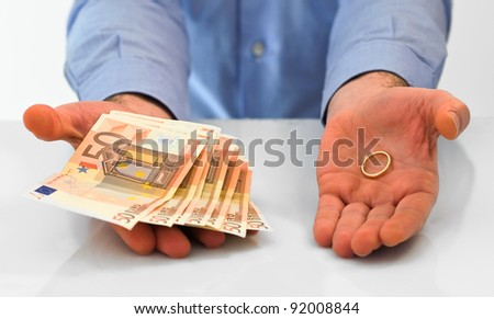 Man with wedding ring and money. - stock photo