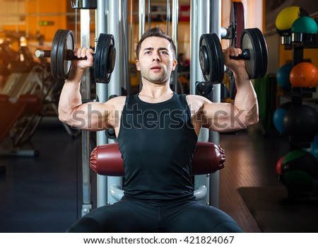 man with weight training equipment on sport gym club.