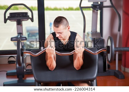 man with weight training equipment on sport gym club- fitness - stock photo