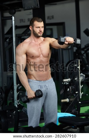 man with weight training equipment on sport in modern gym club