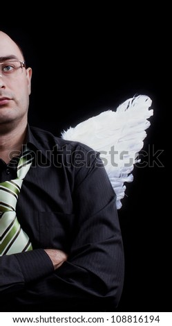 Man with white angel wings behind. One half.