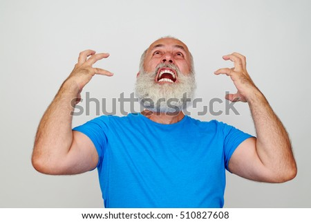 Man with white beard is infuriated and nervous isolated against white background