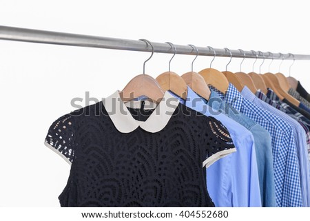 Man with woman shirt and sleeved plaid cotton on a hanger isolated on a white background - stock photo