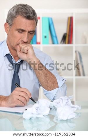 Man with writer's block - stock photo