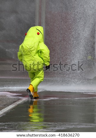 man with yellow protective gear against biological risk - stock photo
