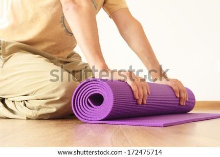 man with yoga mat - stock photo