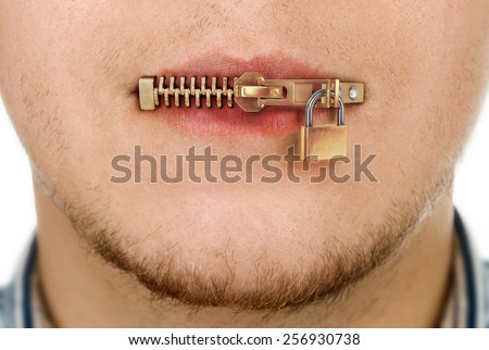 man with zipped mouth - stock photo