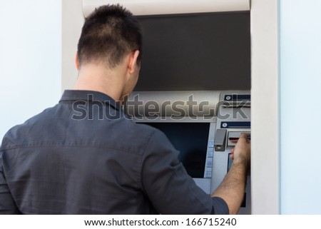 Man withdrawing money