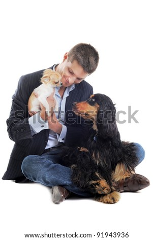 man withe a  purebred english cocker and chihuahua  in a studio