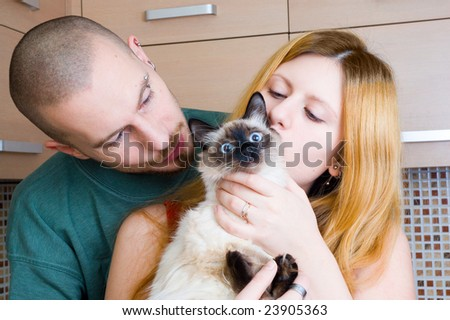 Man, woman and a cat