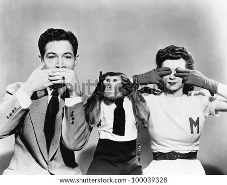 Man, woman and a monkey depicting See No Evil, Speak No Evil, Hear No Evil - stock photo