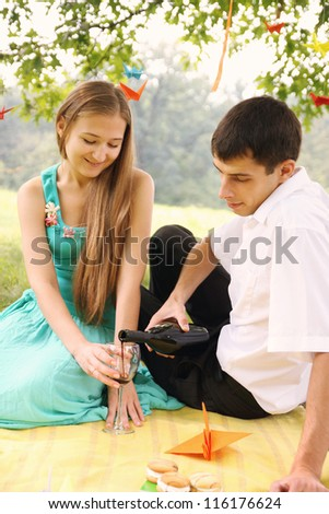Man woman pours wine into a glass - stock photo