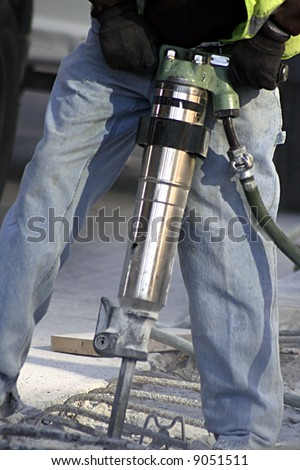 Man working a jack hammer