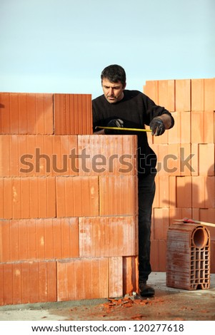 Man working alone on site - stock photo