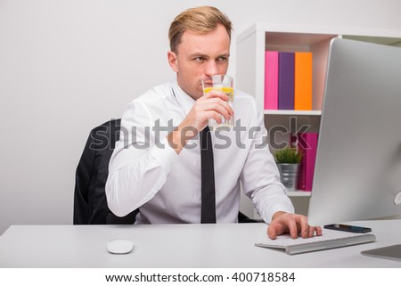 Man working and drinking water at the office