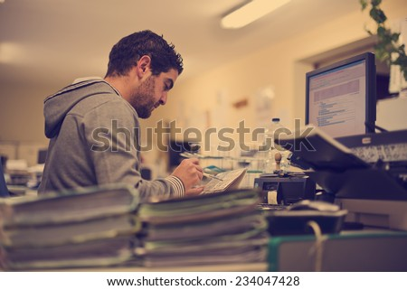 Man working at office with vintage style - stock photo