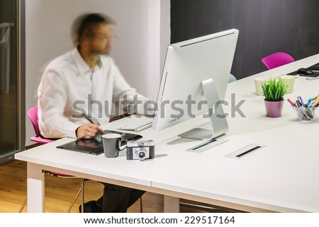 Man Working in a Modern Trendy Office - stock photo