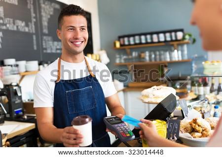 Man working in coffee shop  - stock photo