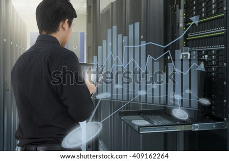 Man working in data center and use tablet for analyze system  - stock photo